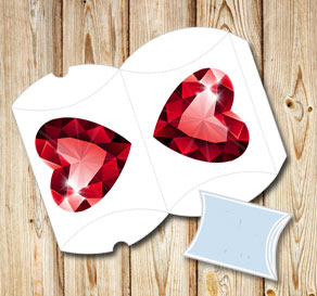 White pillow box with a red heart shaped gem  | Free printable for Valentines day